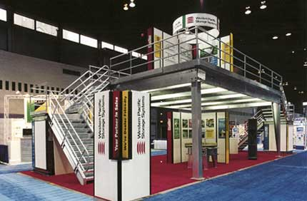 """Industrial Structures mezzanines provide the perfect platform for today's """"over the top"""" trade show exhibits. They are strong, fast to build and design flexible."""