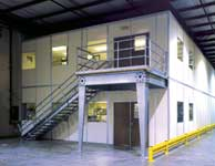A mezzanine and staircase provided an observation deck for this break room area.